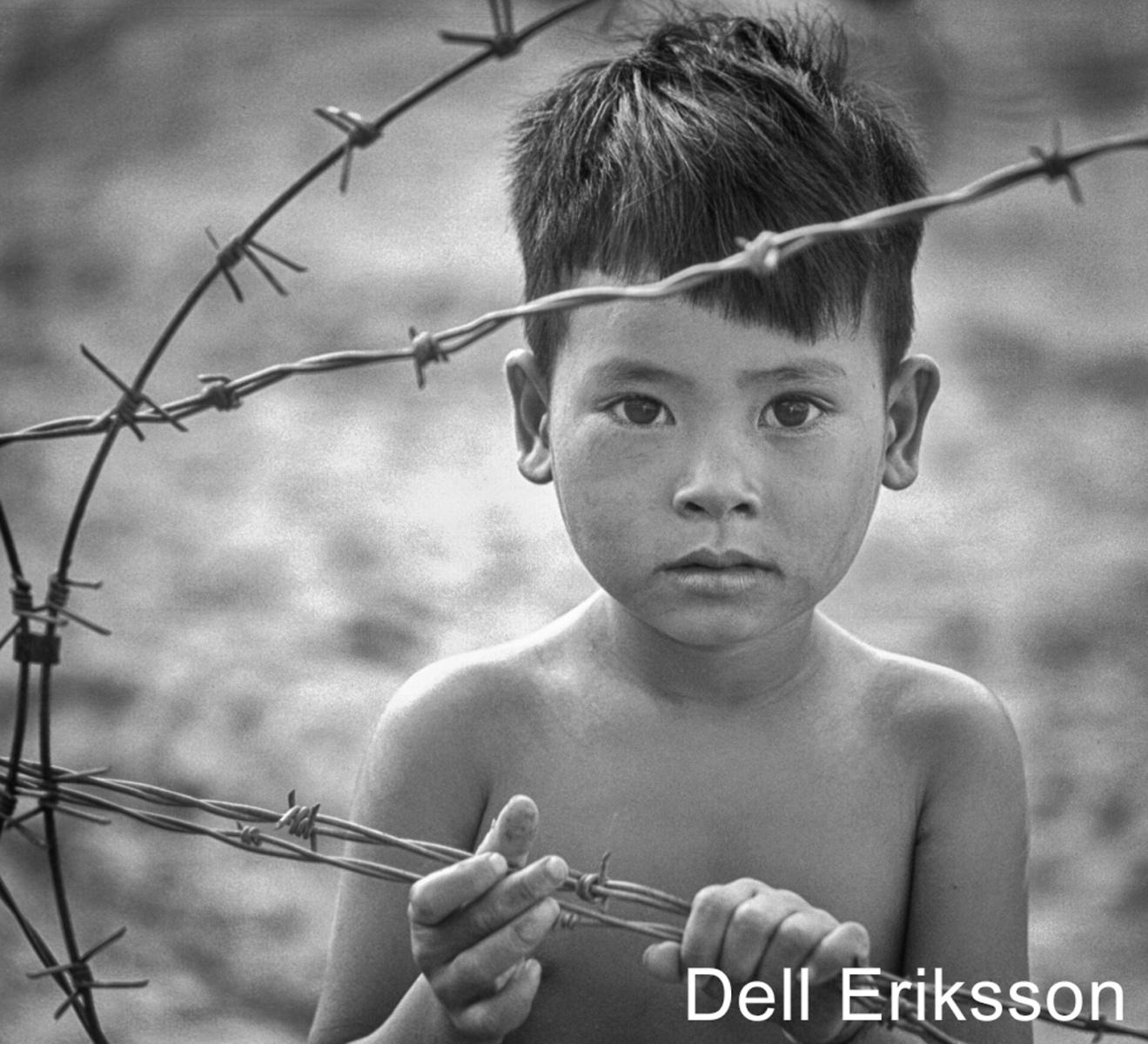 W1-07.Barbed-Wire-Vietnam-Boy